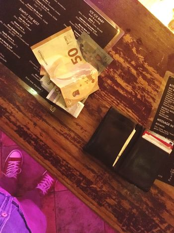 Indoors  High Angle View Communication Text Table Technology No People Wireless Technology Close-up Day 50 EUR Money Club Spend Wood - Material Bar