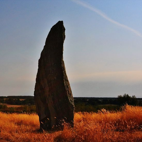 Megalith Standing Stone Prehistoric Afternoon Sun Tranquility Alone Outdoors Non-urban Scene Tranquil Scene Field Sky No People Solitude Sunlight And Shadows Stone Textures Day Bretagne Brittany Sillhouette
