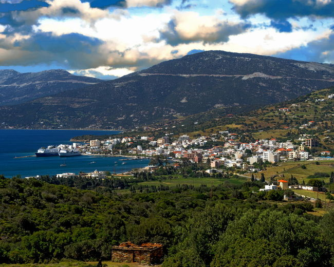 View of the village of Marmari in the southern region of Euboea, Greece Architecture Beauty In Nature Building Exterior Built Structure Cityscape Cloud - Sky Day House Landscape Marmari Greece Mountain Mountain Range Nature No People Outdoors Scenics Sea Sky Town Tranquility Tree Water
