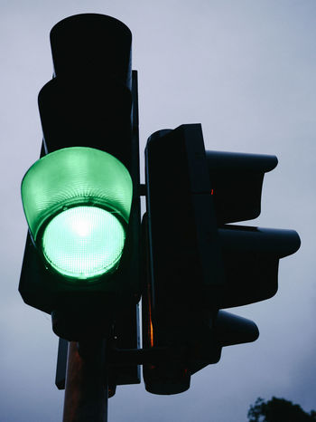 City Close-up Control Day Green Color Green Light Guidance Illuminated Lighting Equipment Low Angle View No People Outdoors Red Light Road Sign Road Signal Safety Sky Stoplight Traffic Transportation