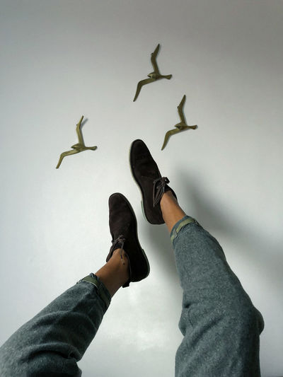 ExpressYourself Fashion Wall Art Flying Birds Flying Legs Shoes ♥ Minimal Minimalobsession Minimalobsession Minimalism Bird Childhood Close-up Day Human Body Part Human Hand Indoors  Low Section Men One Person People Personal Perspective Real People Sky Love Yourself This Is Masculinity Visual Creativity This Is My Skin The Creative - 2018 EyeEm Awards The Portraitist - 2018 EyeEm Awards The Fashion Photographer - 2018 EyeEm Awards A New Perspective On Life Redefining Menswear