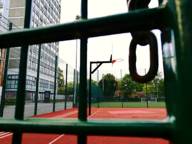 TakeoverContrast Playing with my eyes No People Tranquil Scene Full Frame Day Fence Red Green Color Red Color Green Basquetball Court Empty Empty Places Closed Places City Life City Chain