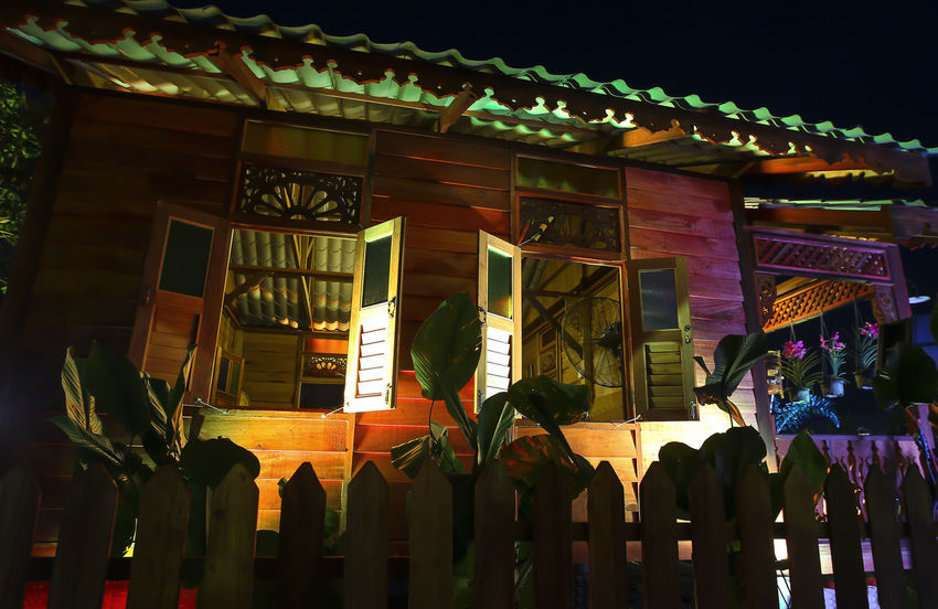 Decoration of a traditional house at Malaysia Architecture Art And Craft Belief Building Building Exterior Built Structure Decoration Illuminated Multi Colored Night Place Of Worship Real People Religion Spirituality