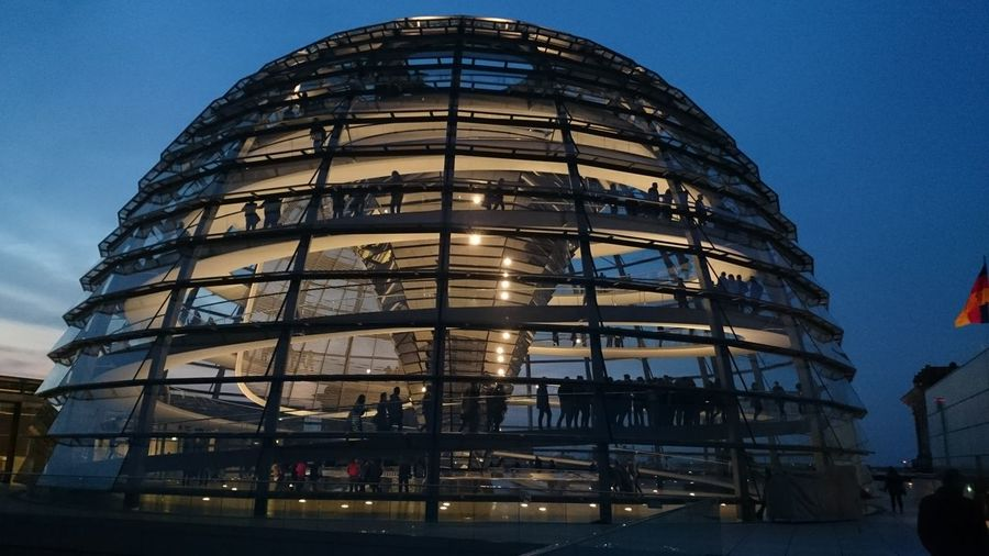 Low angle view of illuminated reichstag building against sky at dusk