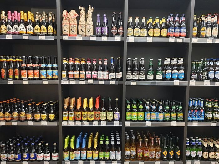 Multi colored bottles on display at store