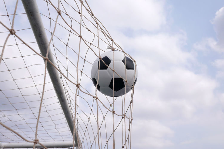 soccer Ball Cloud - Sky Day Football Goal Goal Post Grass Low Angle View Nature Net - Sports Equipment No People Outdoors Playing Sky Soccer Soccer Ball Soccer Field Sport Sports Equipment Team Sport