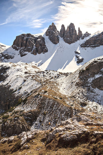 Dolomite Alps, Italy, Europe, Drei Zinnen area at Fall Adriatic, Dolomite, Drei Zinnen, Italy, Adventure, Alps, Area, Coast, Dolmatien, Europe, European, Fall, Hiking, Landscape, Mountains, Nature, Outdoors, Rocks, Sea, Sky, Summer, Sunlight Winter Mountain Scenics - Nature Beauty In Nature Snow Cold Temperature Sky Tranquility Mountain Range Tranquil Scene Cloud - Sky Rock Nature Rock - Object Solid Snowcapped Mountain Day Non-urban Scene No People Mountain Peak Formation