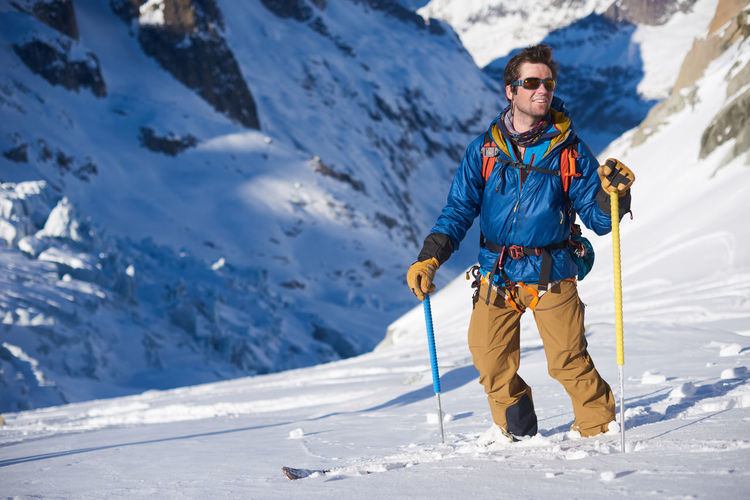 Full length of man skiing on snowcapped mountain