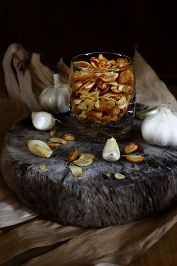 toasted peanuts and garlic chips Food Garlic Chips Roasted Coffee Bean Nuts Peanut Peanuts Snack Time! Snacks! Meal Health Diet Nutrition Taste Flavor Delicious Ingredient Salty Wood - Material Table Homemade Close-up Peanut - Food Garlic Bulb Nut - Food Garlic Clove