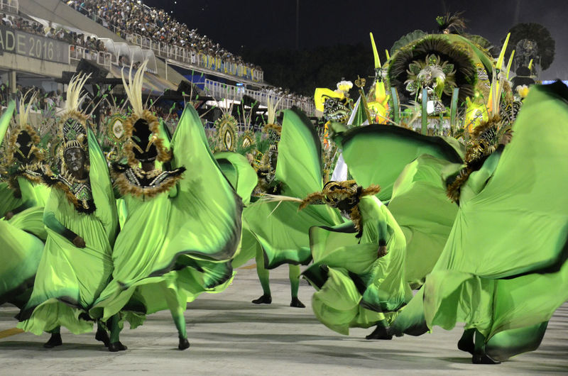 People In Costumes Dancing At Carnival