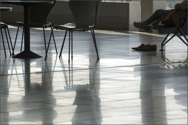 Düsseldorf. Waiting room at the airport. Düsseldorf Waiting Room Of Hell Absence Airport Airportphotography Chair Day Flooring Group Of People Hardwood Floor Human Leg Indoors  Low Section People Real People Reflection Relaxation Seat Shadow Sunlight Table Waiting Waiting Room Waiting Rooms Wood