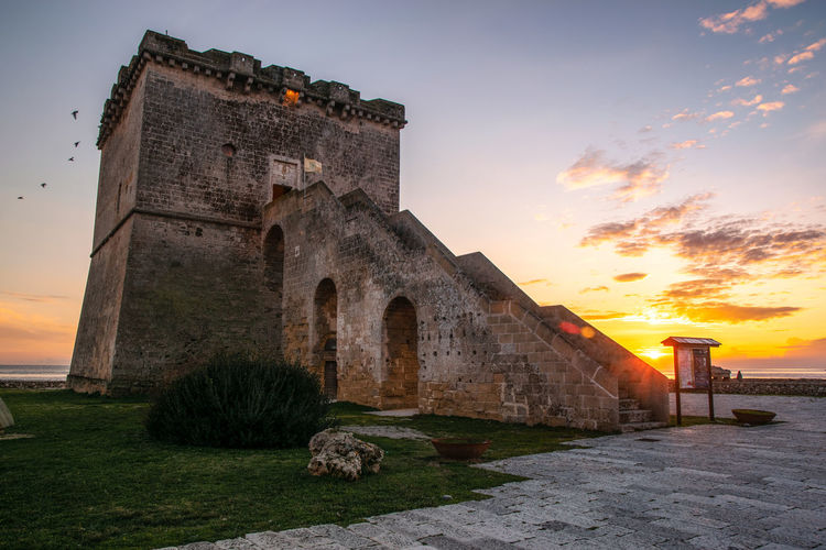 Architecture Built Structure Sky History Sunset Building Exterior The Past Nature Cloud - Sky Building Old Plant Orange Color No People Ancient Outdoors Arch Castle Religion Travel Destinations Ancient Civilization Stone Wall Ruined Tower Salento