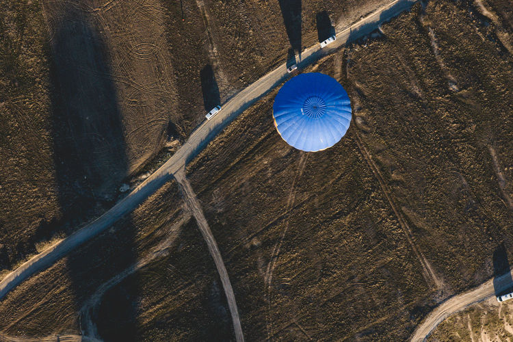 Aerial view of hot air balloon by road