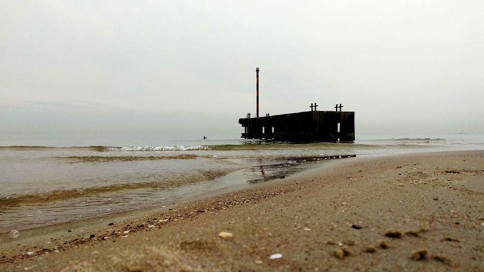 By the seashore... Fog Foggy Morning FogyDay Sand Oil Pump Water Sea Beach Sky Built Structure Water Pollution Sandy Beach Foggy Shore