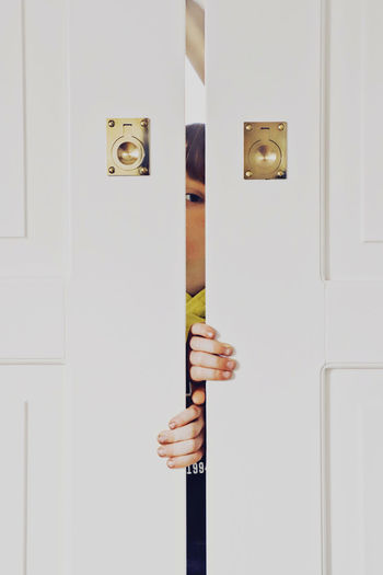 Child Childhood Eyes Door Entrance One Person Human Hand Human Body Part Hand Indoors  Body Part Unrecognizable Person Holding White Color Close-up Real People Young Adult Closed Handle Metal Standing Studio Shot Finger