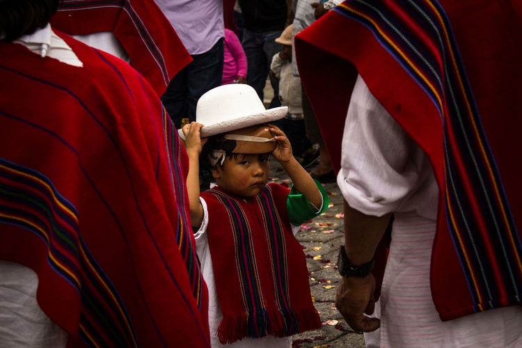 Boy standing in traditional clothing