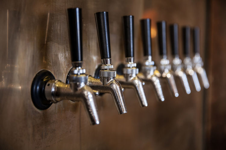 Beer - Alcohol Beer Tap Brass Choice Close-up Equipment Food And Drink Food And Drink Industry In A Row Indoors  Industry Metal Music Musical Instrument No People Quality Control Selective Focus Silver - Metal Silver Colored Steel Work Tool