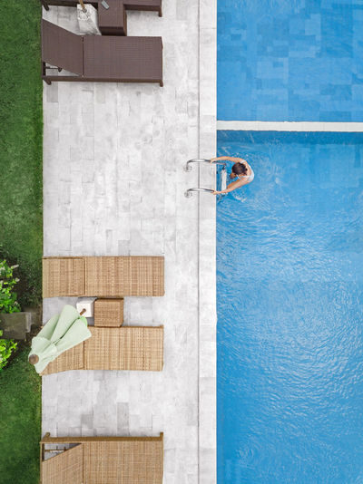 Directly above shot of person holding swimming pool