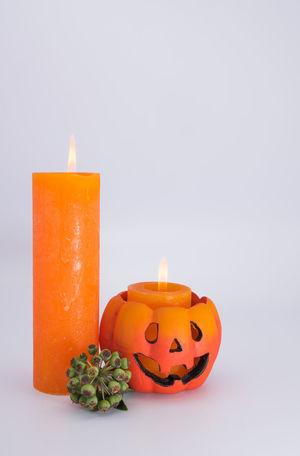 Advent Atmospheric Mood Burning Candle Celebration Colored Background Flame Gray Background No People Orange Color Studio Shot Tea Light Yellow