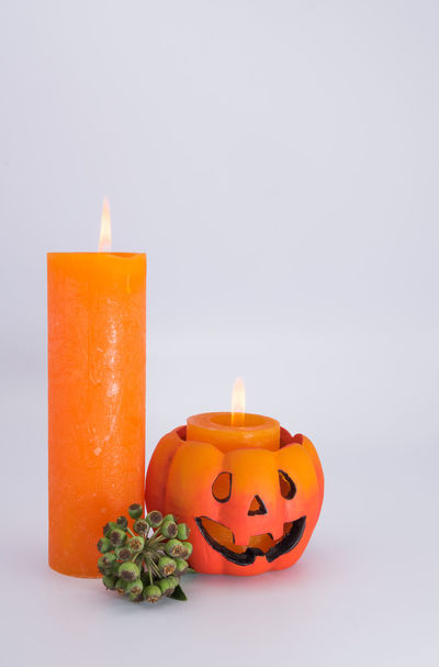 Advent Atmospheric Mood Burning Candle Celebration Colored Background Flame Gray Background No People Orange Color Studio Shot Tea Light Yellow