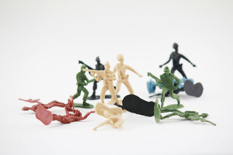 Close-up of plastic toys over white background