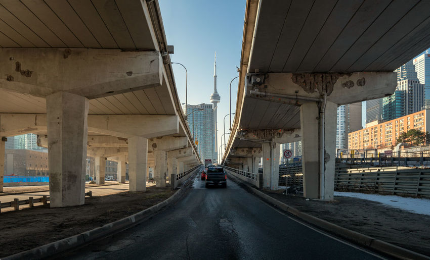 Underneath Toronto highway with view on CN tower Architecture Built Structure Transportation Bridge Connection Bridge - Man Made Structure Road No People City Mode Of Transportation The Way Forward Land Vehicle Overpass Diminishing Perspective Car Underneath Toronto Highway CN Tower Daytime Sunshine Motor Vehicle Architectural Column My Best Photo