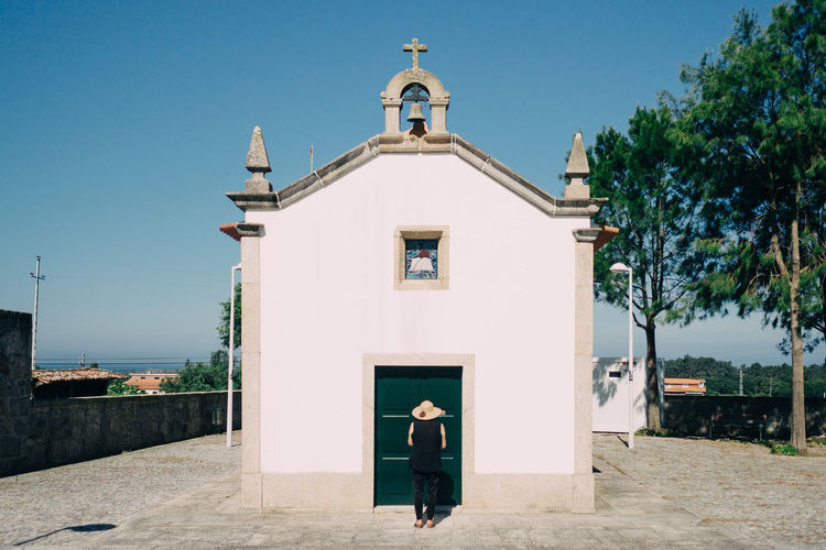 Woman Standing In Front Of Church