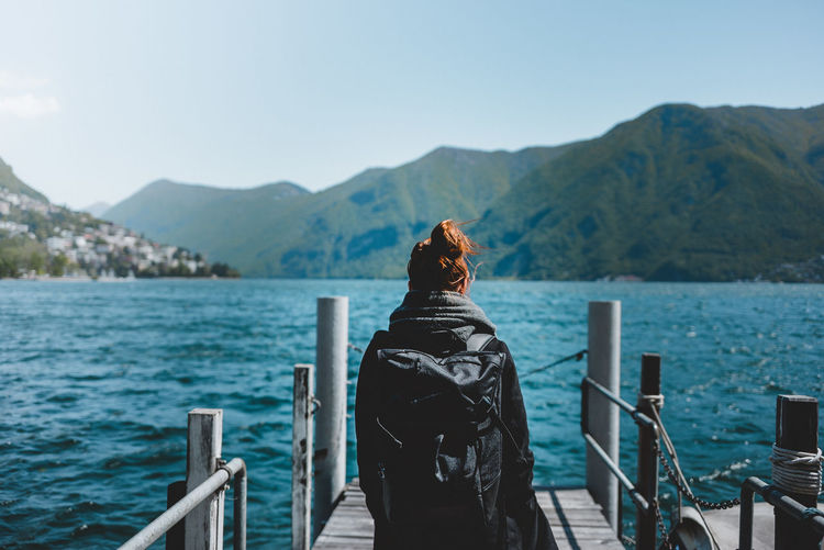 Sea of Lugano Beauty In Nature Day Empty Focus On Foreground Freedom Leisure Activity Lifestyles Mountain Mountain Range Nature One Person Outdoors People Real People Rear View Scenics Sea Seaview Sky Standing The Great Sea Tranquility Vacation Water Women