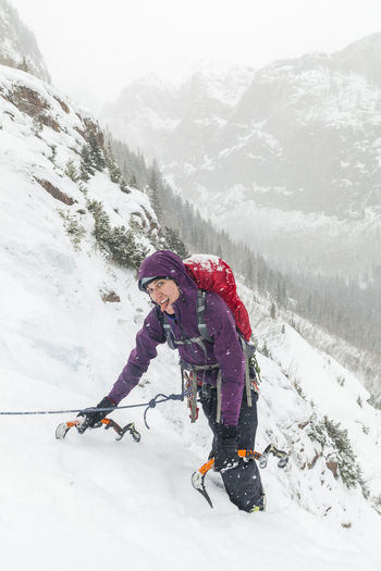 Full length of person on snowcapped mountains during winter