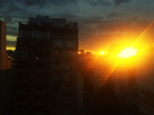 Sun Set Now. Sky Sunset Architecture Sun Built Structure Building Exterior A New Perspective On Life Cloud - Sky Orange Color City Building Silhouette Sunlight