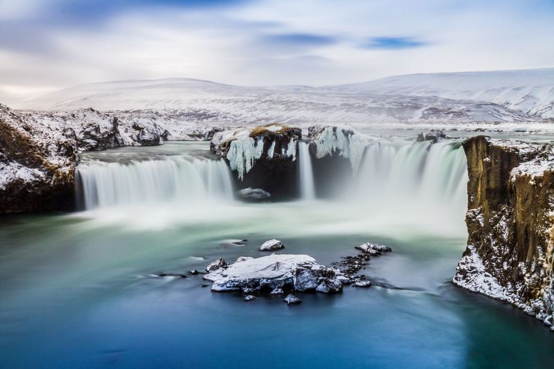 Godafoss Waterfall in Winter Tourist Attraction  Travel Destinations Iceland Long Exposure Photography Water Scenics - Nature Beauty In Nature Cloud - Sky Sky Long Exposure Nature Tranquil Scene Environment Waterfall Travel Destinations Tranquility Cold Temperature Travel Flowing Water