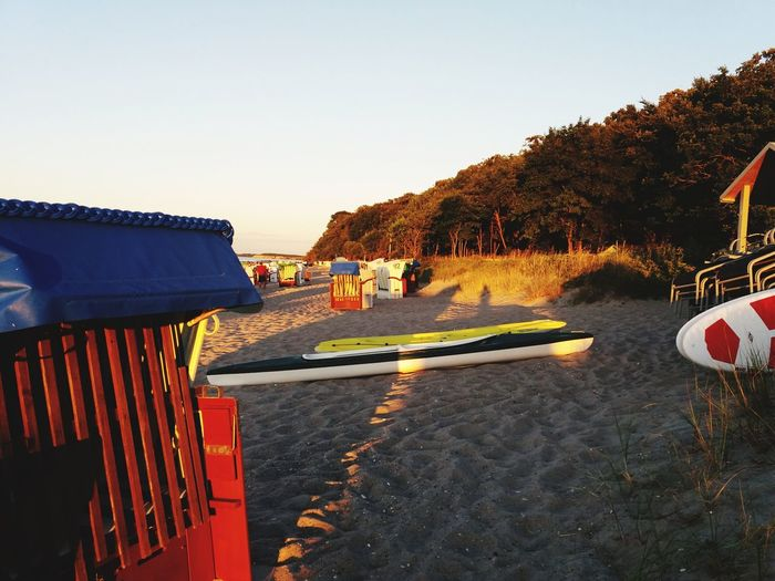 Red Beach Life Beach Beachchair Sunset_collection Evening Sun Abendstimmung Am Meer Baltic Sea Hohwacht EyeEm Nature Lover Tree Clear Sky Sunset Sky The Still Life Photographer - 2018 EyeEm Awards