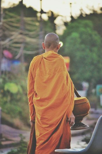 Robe Rear View Only Men Religion Spirituality Monk  Buddhism Walking Around The City  Real People Rear View Resist Long Goodbye The Photojournalist - 2017 EyeEm Awards