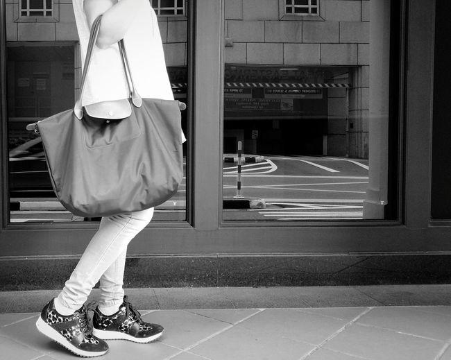 Side View Of Woman Walking With Handbag