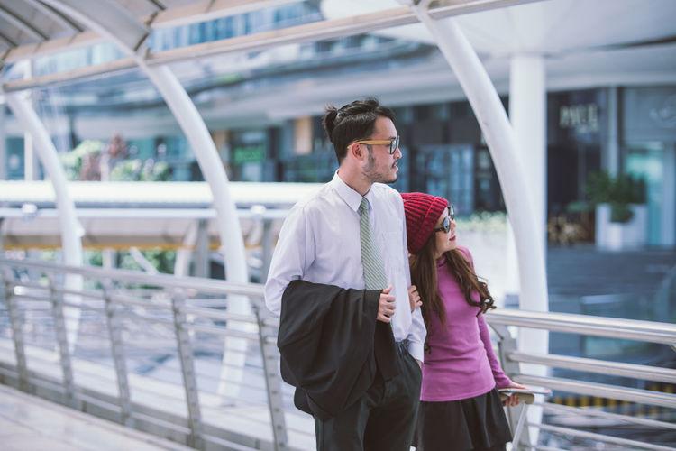 Couple Standing On Elevated Walkway