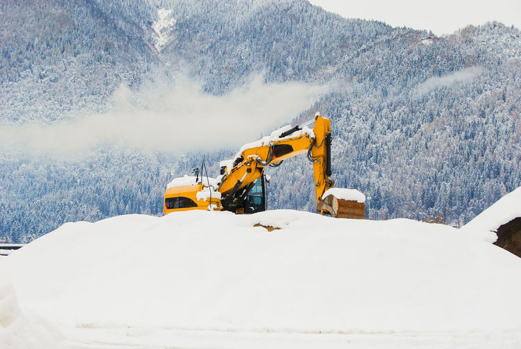Panoramic view of construction site during winter