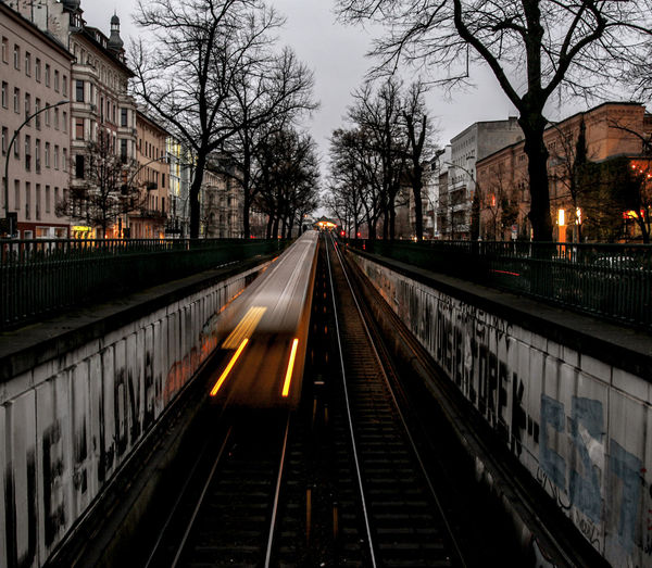 Railroad Tracks In City At Night