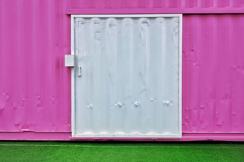 White Door On Pink Metallic Cargo Container