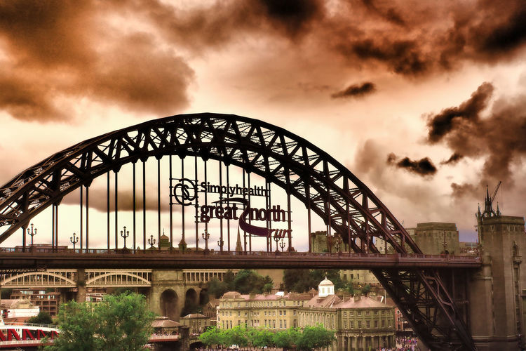 Newcastle upon Tyne on the Great North Run weekend 2017 Architecture City Sky Day Newcastle Upon Tyne Outdoors Storm Clouds Arch Runners Connection No People Lots Of People Great North Run Travel Destinations Low Angle View Cloud - Sky Building Exterior Built Structure Bridge - Man Made Structure Orange Glow Newcastle Bridges River Tyne,