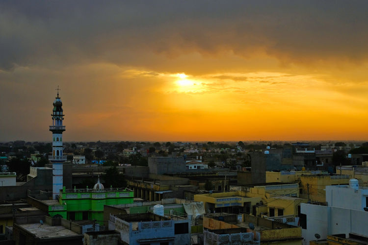 Sunset over old town old Mandawa, India. ASIA India Mandawa, Rajasthan Old Town Architecture Building Building Exterior Built Structure City Cityscape Cloud - Sky High Angle View Mandawa Nature No People Old City Orange Color Outdoors Residential District Romantic Sky Sky Sun Sunset Tower Travel Destinations