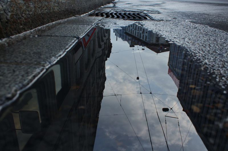 High angle view of reflection of buildings in city
