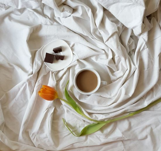 Lazy Day White Bed Sheets Rumpled Linen Coffee Milk Cup Dark Chocolate My Favorite Breakfast Moment Orange Tulip Green Leaves Flower Petals Delicious Smell Flowers Spending Time Bed Porcelain  Minimalism Free Time Interior Design