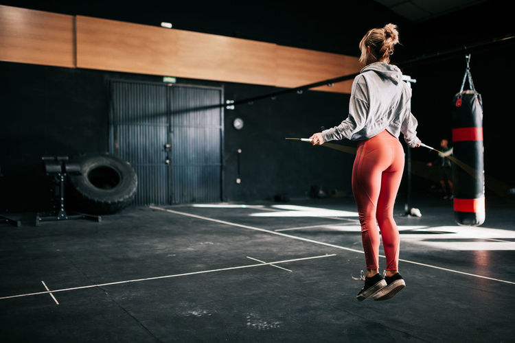 Full length rear view of woman standing in stadium