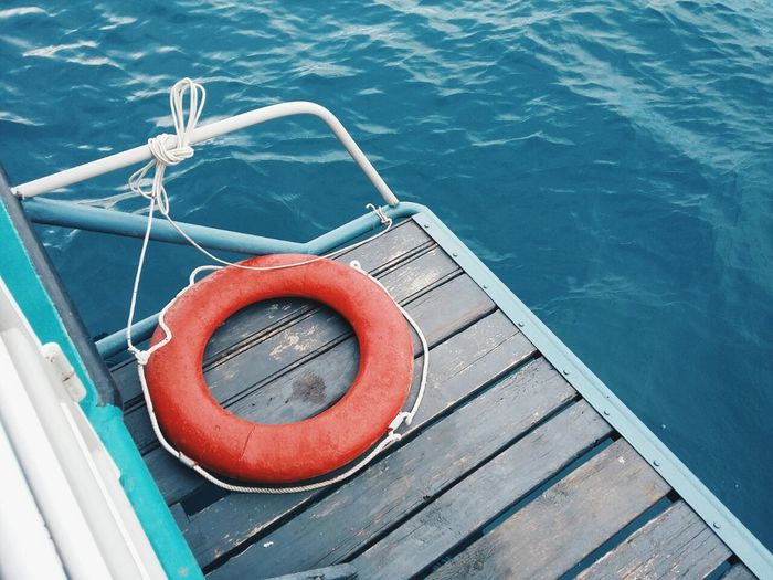 High angle view of life belt on boat in sea