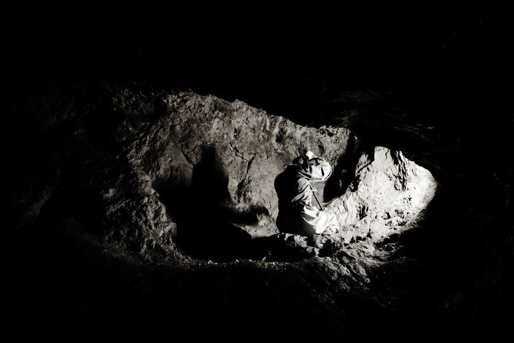 Shadow Shape Dark Darkness Blackandwhite Black And White Hole Rock Rock - Object One Person One Person Only Copy Space Illuminated Labor WORKHARD Hard Labor Mine Nature Working Human Hand Close-up Cave The Photojournalist - 2018 EyeEm Awards EyeEmNewHere