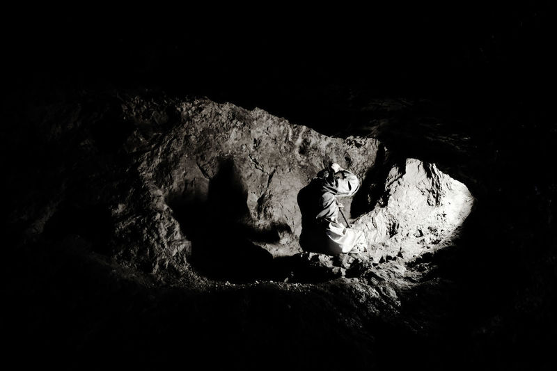 Shadow Shape Dark Darkness Blackandwhite Black And White Hole Rock Rock - Object One Person One Person Only Copy Space Illuminated Labor WORKHARD Hard Labor Mine Nature Working Human Hand Close-up Cave The Photojournalist - 2018 EyeEm Awards EyeEmNewHere HUAWEI Photo Award: After Dark