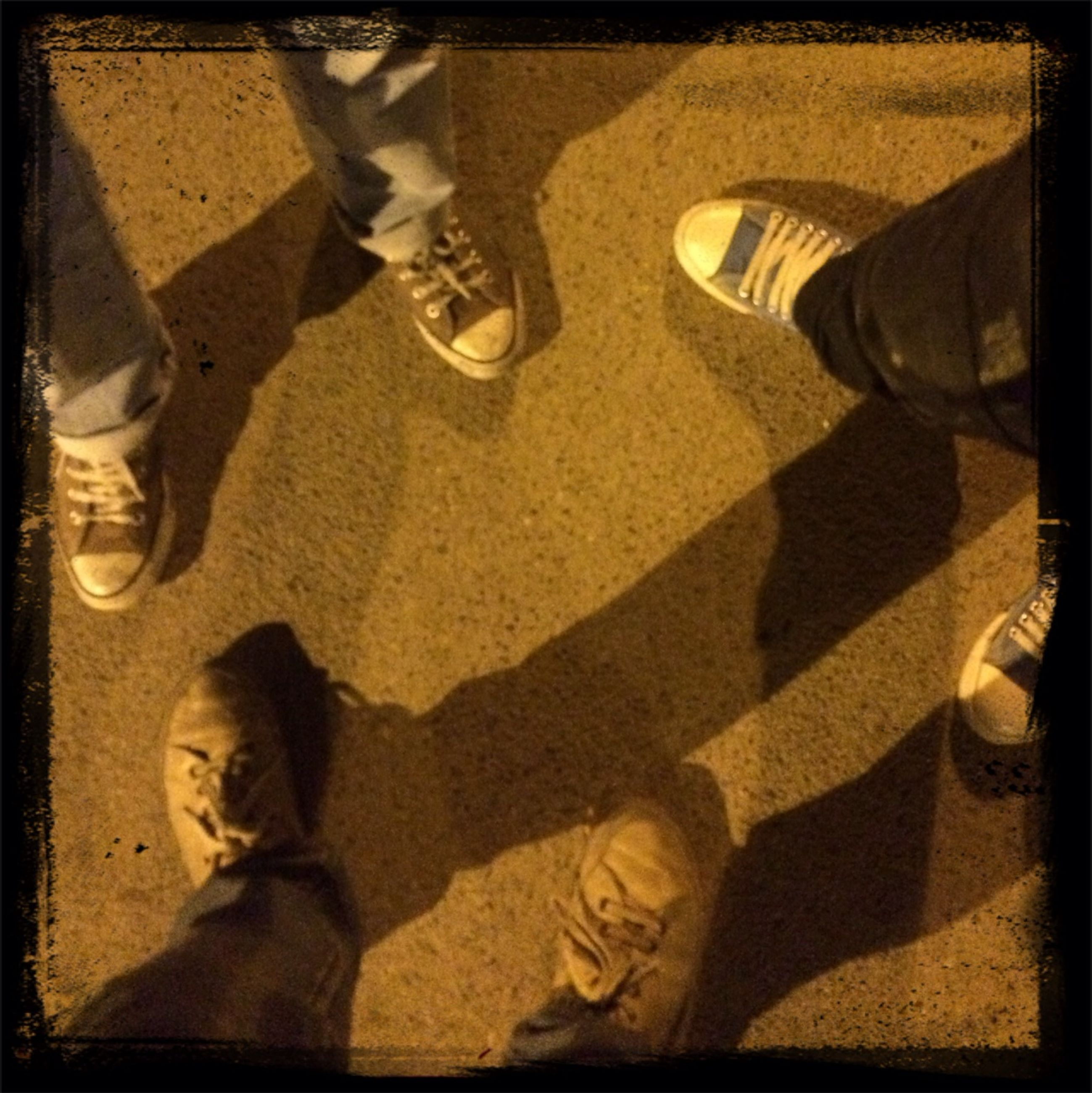 low section, transfer print, person, lifestyles, auto post production filter, high angle view, shoe, men, leisure activity, togetherness, human foot, street, standing, personal perspective, shadow