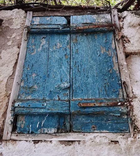 Low angle view of closed door of old house