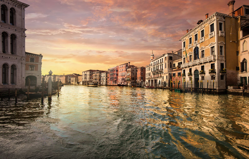 Canale Grande at sunset in Venice Italy Architecture Building Exterior Built Structure Water Sky City Sunset Cloud - Sky Reflection Building Waterfront Canal Nature No People Residential District Travel Destinations Orange Color Nautical Vessel Outdoors Gondola - Traditional Boat Venice, Italy Waves Canal Grande Architecture Old Archival Vintage Beautyful  Way Street Rialto Bridge Historical Pattern Dramatic Sky Colorful Travel Tourism Vacations Summer Spring Sunrise Tranquility Scenics View Famous Place Panorama Italy Europe Nobody Boats