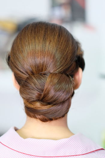 Rear View Of Woman With Hair Bun